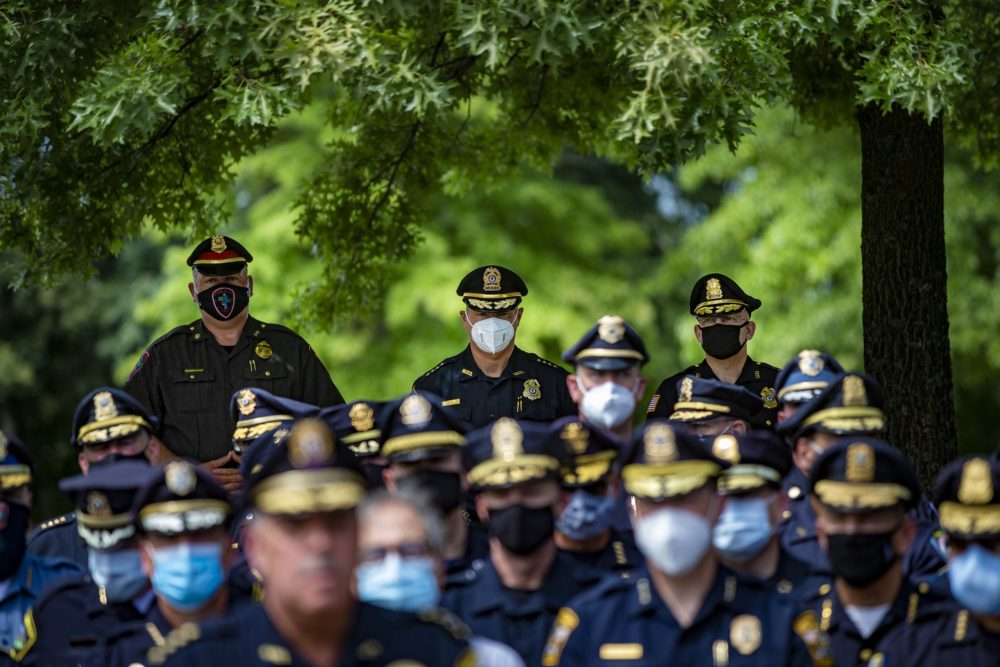 Police chiefs from across the commonwealth gathered in Framingham this summer to protest the early versions of the police reform bill. (Jesse Costa/WBUR)