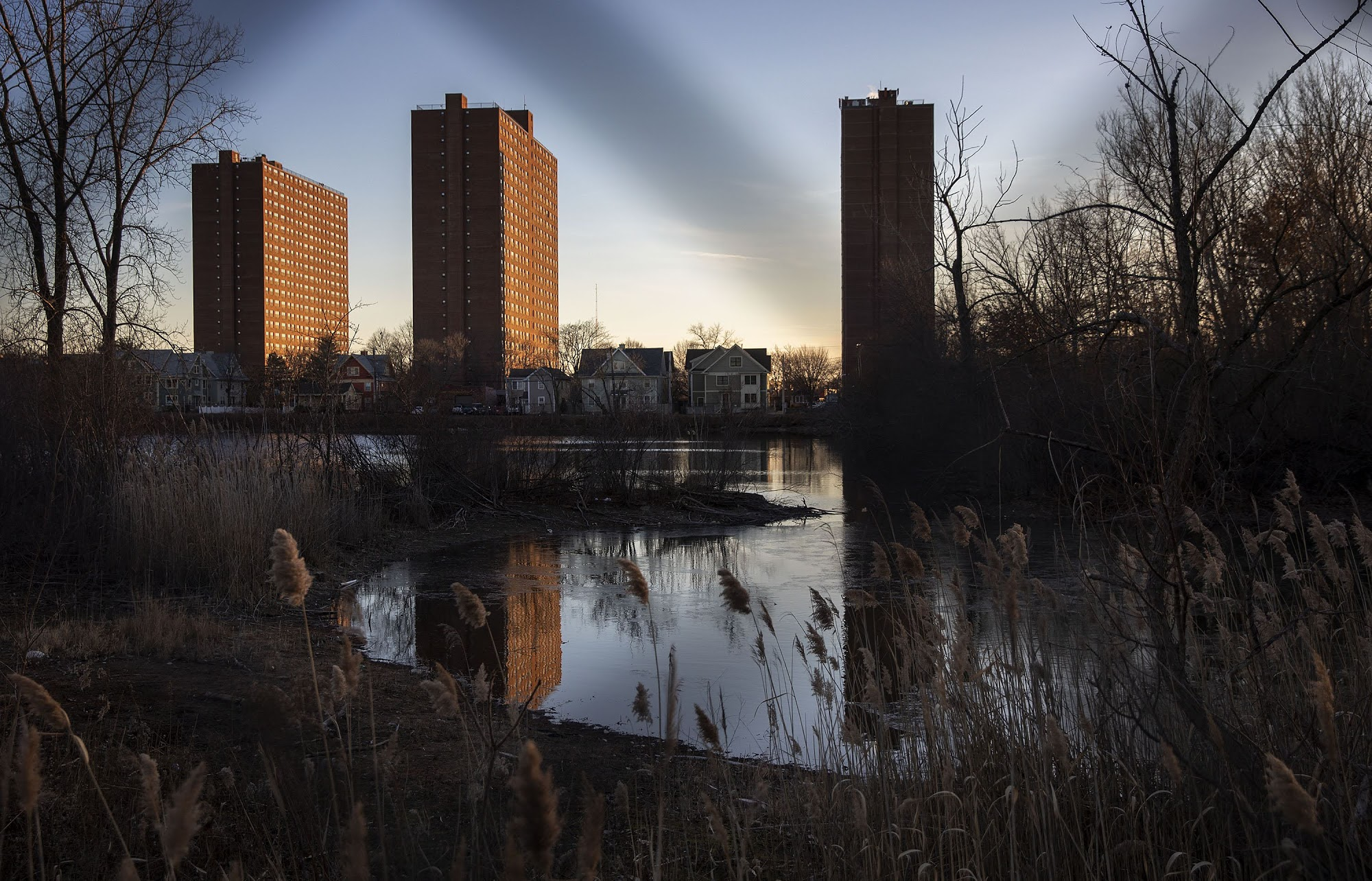 Rindge Towers on a winter evening seen from across Jerry's Pond. (Robin Lubbock/WBUR)