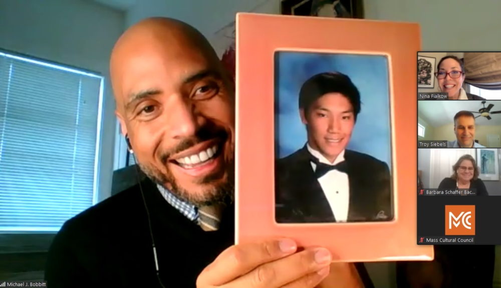 Michael Bobbitt, selected Friday as the new executive director of the Massachusetts Cultural Council, held up a photo of his son, Sang, as he introduced himself to the council's governing board during a Zoom call. (Screenshot/State House News Service)