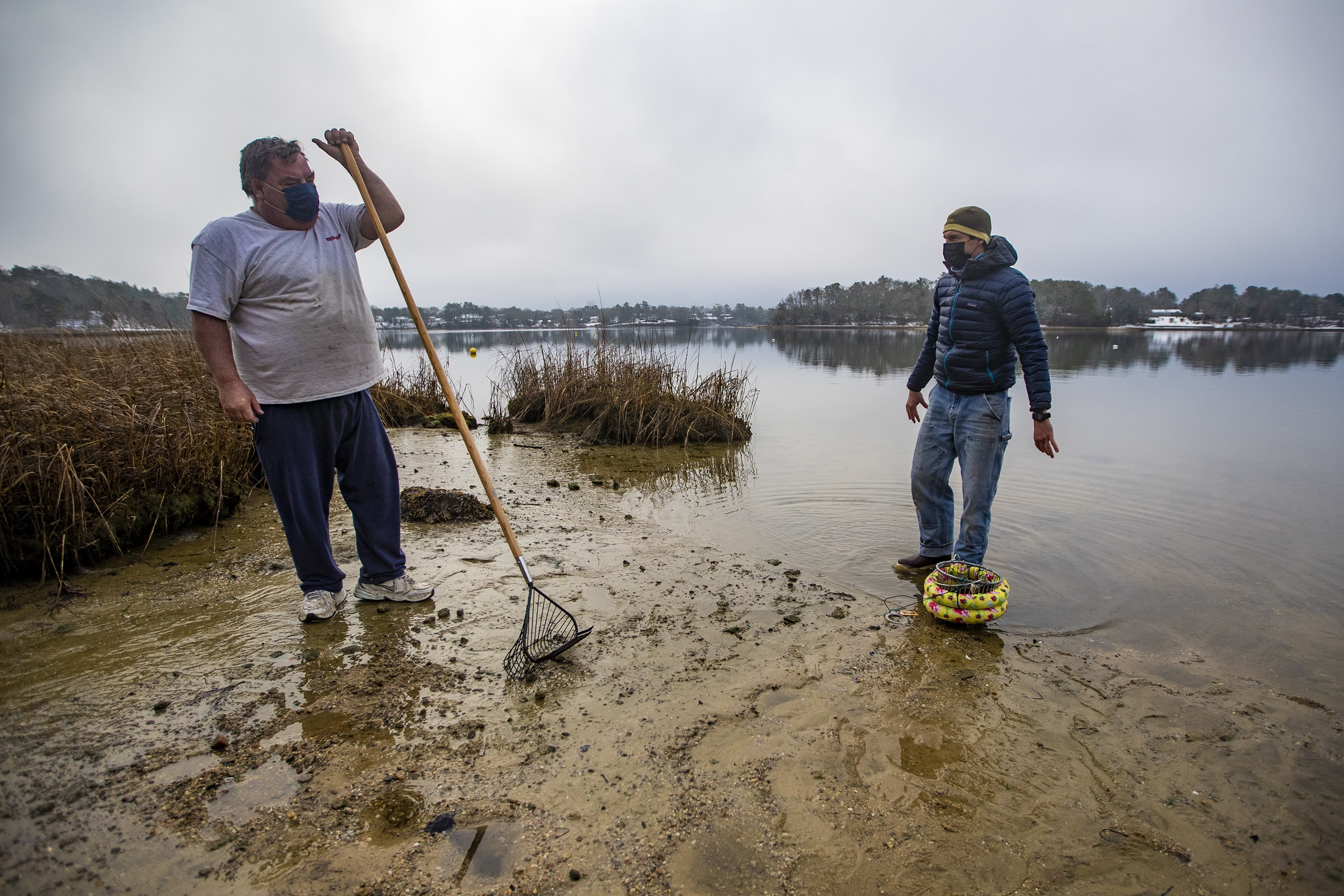 Oyster farmer Bruce Silverbrand, left, and coastal program manager for the Nature Conservancy, Steven Kirk, at Little Buttermilk Bay in Buzzards Bay. (Jesse Costa/WBUR)