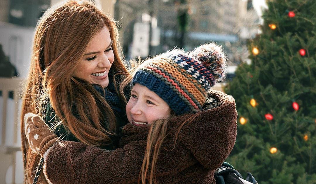 "Isla Fisher (left) and Willa Skye in ""Godmothered."" (Courtesy Disney+)"