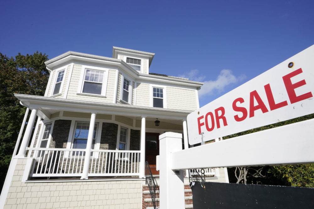 A for sale sign stands in front of a house, Tuesday, Oct. 6, 2020, in Westwood, Mass. (AP Photo/Steven Senne)