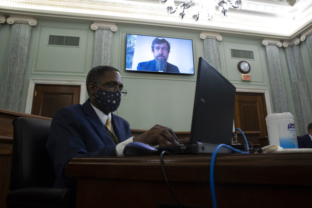 Twitter CEO Jack Dorsey appears on a screen as he speaks remotely during a hearing before the Senate Commerce Committee on Capitol Hill, Wednesday, Oct. 28, 2020, in Washington. The committee summoned the CEOs of Twitter, Facebook and Google to testify during the hearing. (Michael Reynolds/Pool via AP)