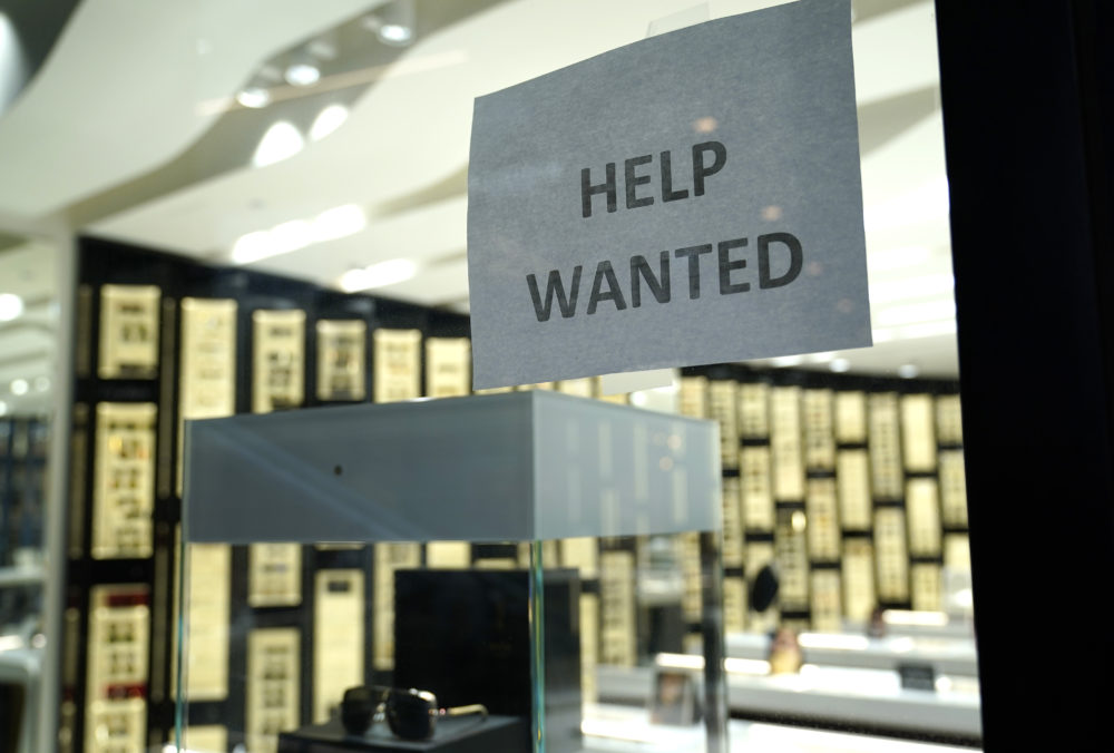 A Help Wanted sign is posted at a Designer Eyes store at Brickell City Centre, Friday, Nov. 6, 2020, in Miami.(Lynne Sladky/AP)