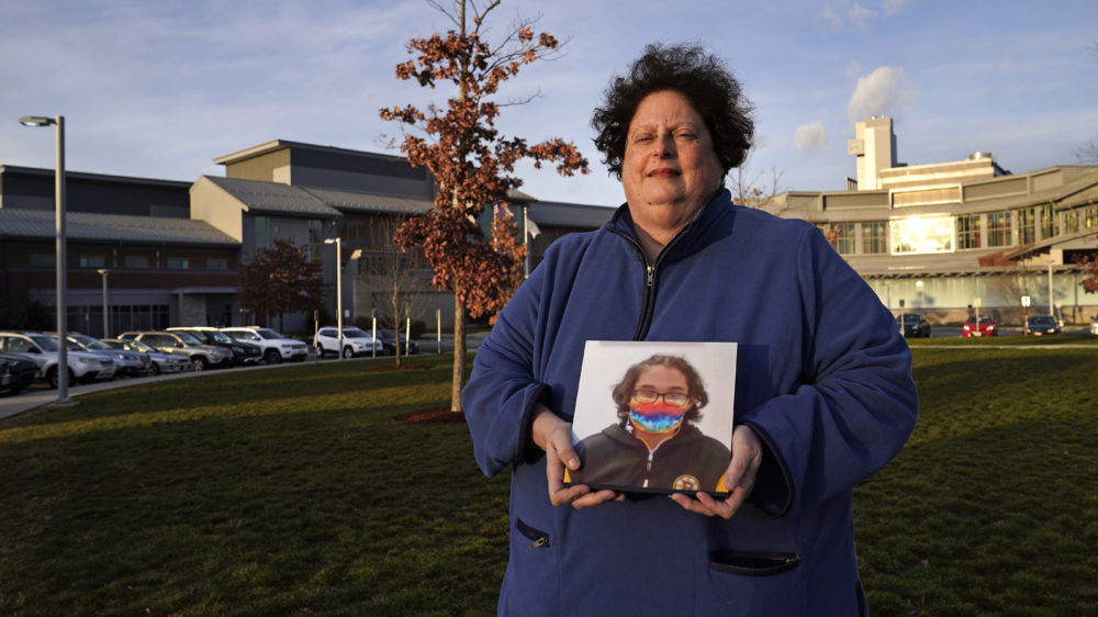 Laura Dilts, of Barre, holds a photograph of her 16-year-old son outside the Worcester Recovery Center in Worcester, where he is a resident patient receiving assistance for his mental health. The coronavirus pandemic has led to rising emergency room visits and longer waits for U.S. children and teens facing mental health issues. (Charles Krupa/AP)