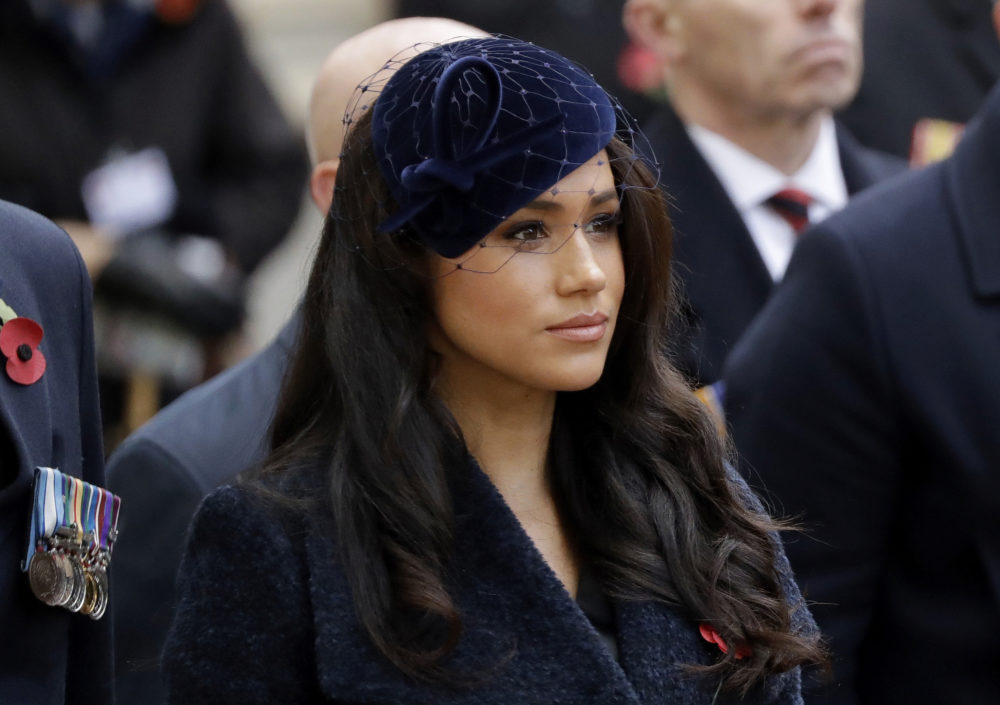 """In this Thursday, Nov. 7, 2019 file photo Meghan the Duchess of Sussex stands after she and her husband Britain's Prince Harry placed a Cross of Remembrance as they attend the official opening of the annual Field of Remembrance at Westminster Abbey in London. The Duchess of Sussex has revealed that she had a miscarriage in July. Meghan described the experience in an opinion piece in the New York Times on Wednesday. She wrote: """"I knew, as I clutched my firstborn child, that I was losing my second."""" The former Meghan Markle and husband Prince Harry have a son, Archie, born in 2019. (Matt Dunham/AP)"""