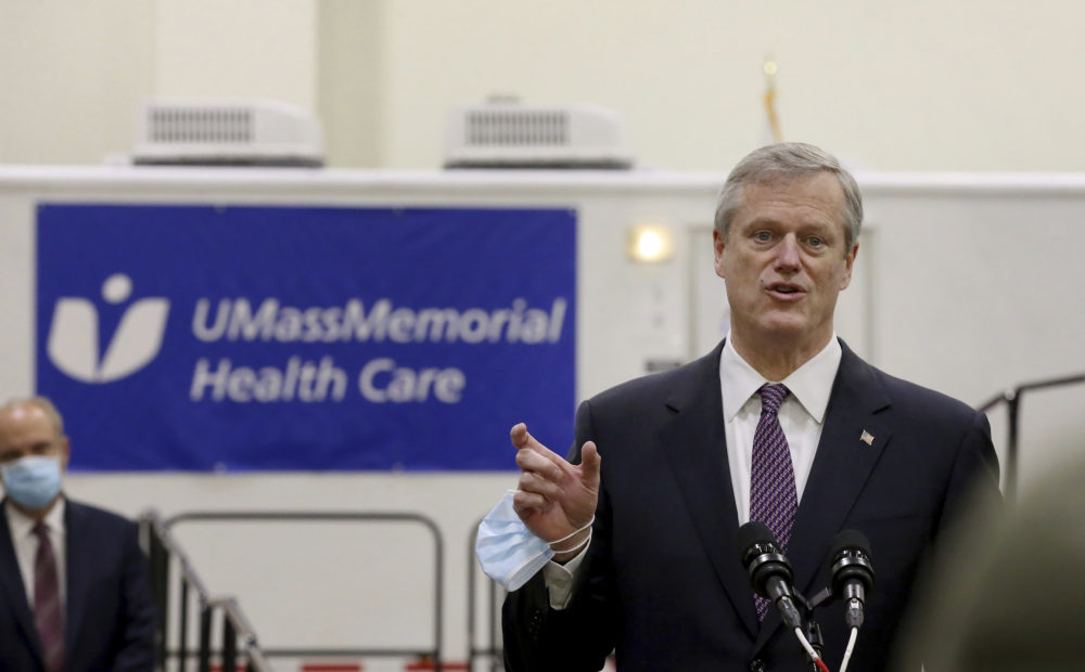 Gov. Charlie Baker speaks after touring the DCU Center as it gears up to be used as a COVID-19 field hospital for the second time on Thursday, Dec. 3, 2020 in Worcester, Mass. (Nancy Lane/The Boston Herald via AP, Pool)