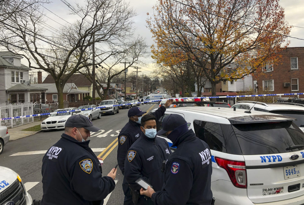 New York Police officers block off the street near the scene where a suspect was killed during a shootout with U.S. marshals in the Bronx that left two officers wounded, Friday, Dec. 4, 2020, in New York. The suspect, 35-year-old Andre Sterling, was wanted for shooting a Massachusetts state trooper in the hand on Nov. 20 during a traffic stop in Hyannis, Mass. (AP Photo/Mark Lennihan)