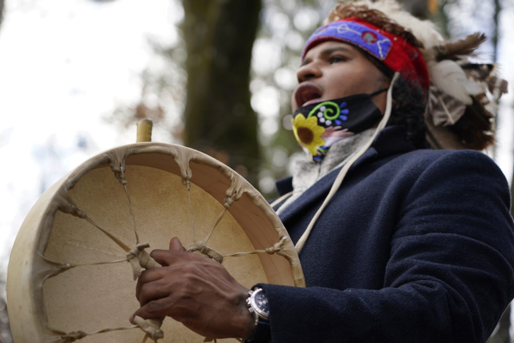 Larry Fisher, chief sachem of the Mattakeeset Massachuset tribe, sings and drums a traditional song honoring their land and ancestry at Titicut Indian Reservation, Nov. 27, 2020, in Bridgewater, (Elise Amendola/AP)