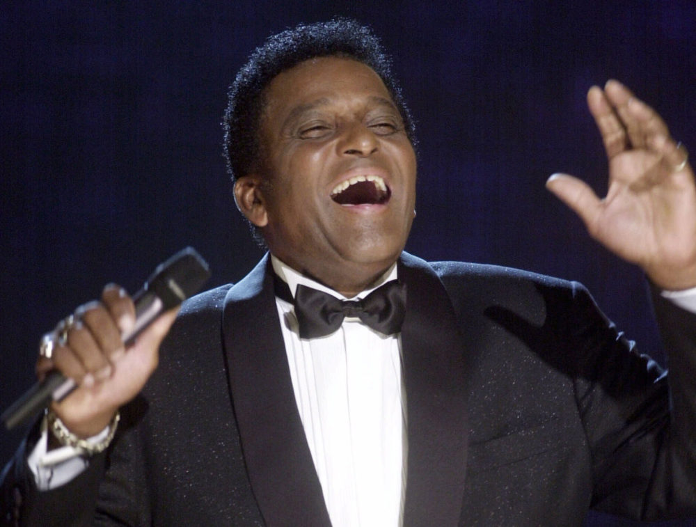 In this Oct. 4, 2000, photo, Charlie Pride performs during his induction into the Country Music Hall of Fame at the Country Music Association Awards show at the Grand Ole Opry House in Nashville, Tenn. Pride, the son of sharecroppers in Mississippi and became one of country music's biggest stars and the first Black member of the Country Music Hall of Fame, has died at age 86. (Charlie Neibergall/AP)
