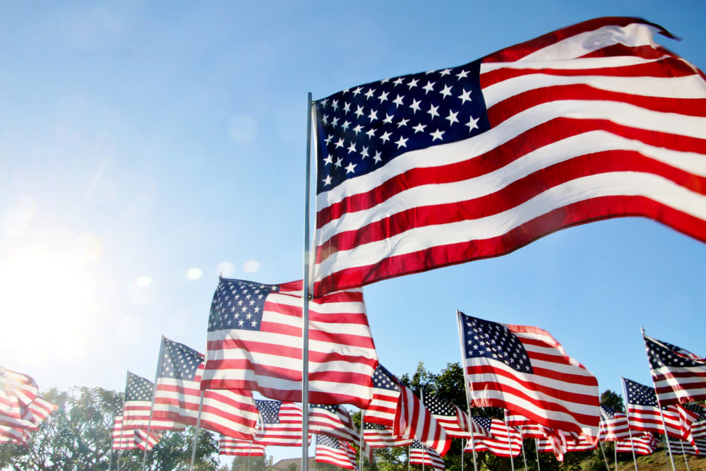U.S. flags blow in the wind in Malibu, California. (Getty Images)