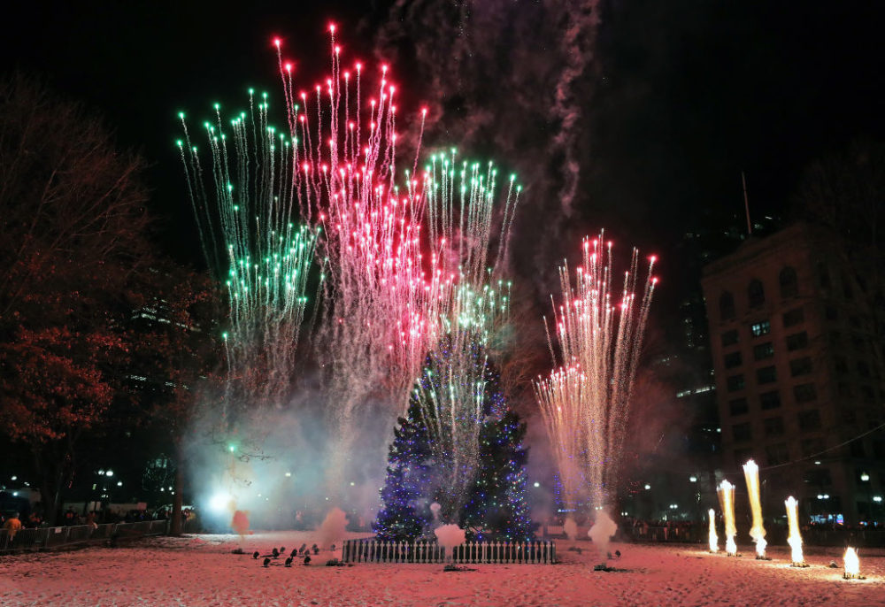 BOSTON, MA - DECEMBER 5: Fireworks explode around the Christmas tree on Boston Common at the conclusion of the festivities at the 78th annual tree lighting at the Boston Common on Dec. 5, 2019. (Photo by Jim Davis/The Boston Globe via Getty Images)