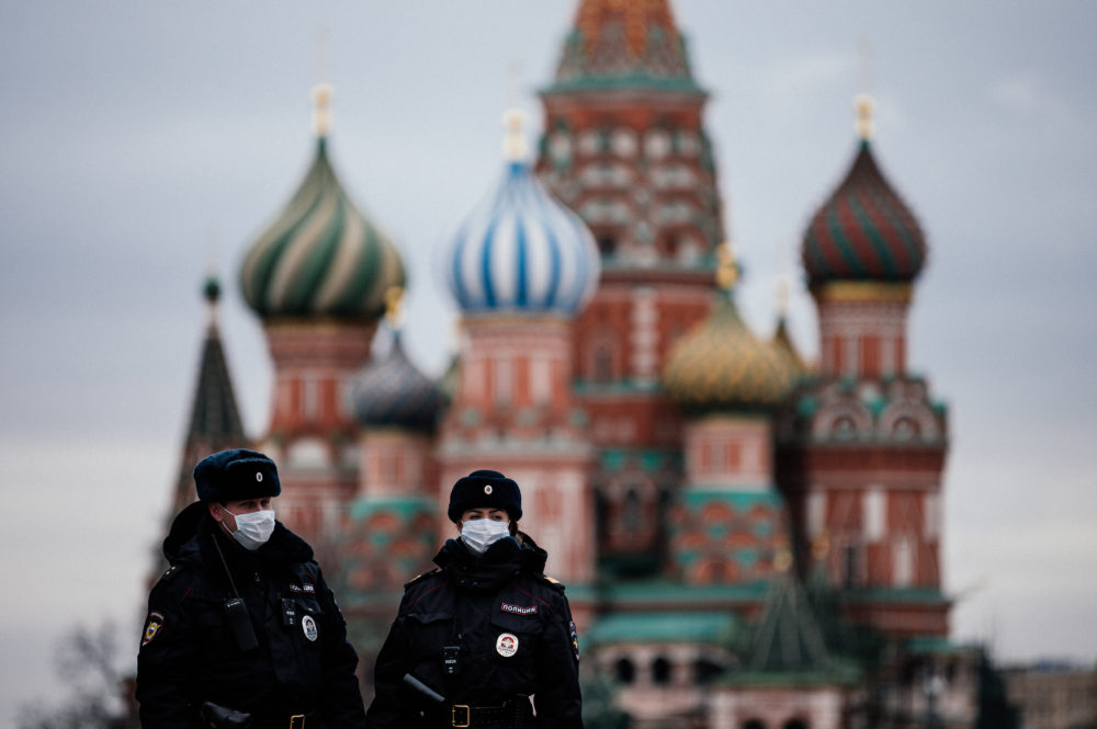 Russian police officers patrol on March 30, 2020 on the deserted Red square in front of Saint Basil's Cathedral in Moscow as the city and its surrounding regions imposed lockdowns. (Dimitar Dilkoff/AFP/Getty Images)