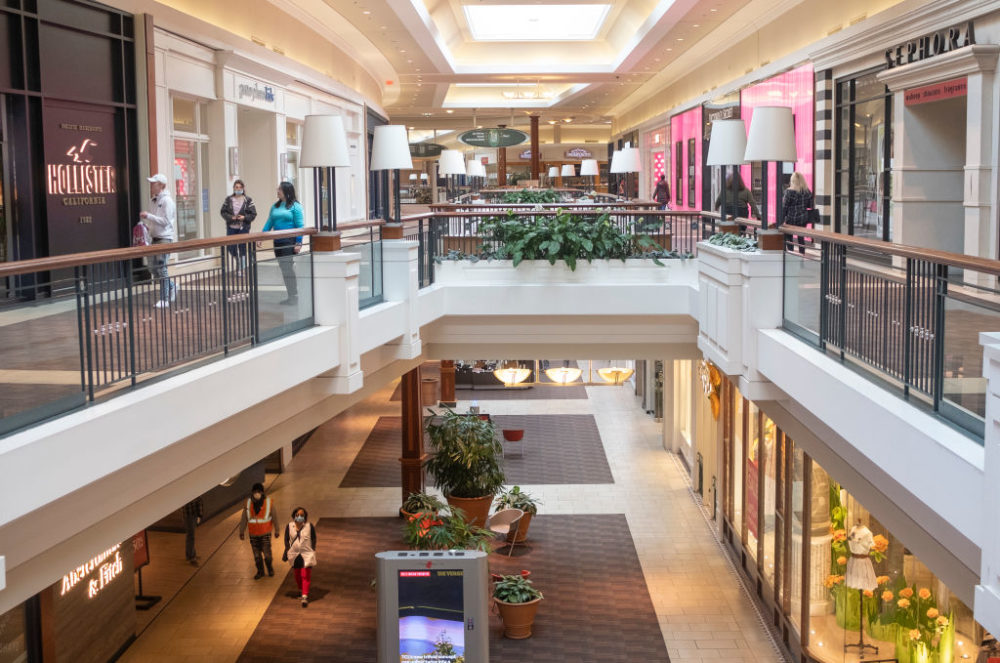 In May 2020, shoppers explore a mostly empty mall where several stores have reopened for the first time since Ohio Gov. Mike DeWine's shut down of all non-essential businesses in mid March amid the coronavirus pandemic in Columbus, Ohio. (Matthew Hatcher/Getty Images)