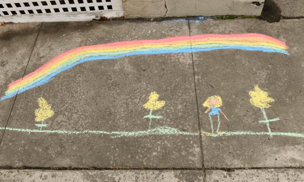 A chalk drawing by Abigail Fichthorn, 8, and her mother Jeanni Fichthorn, outside their home on Penn Ave in Wernersville, Penn. on March 24, 2020. (Ben Hasty/MediaNews Group/Reading Eagle via Getty Images)