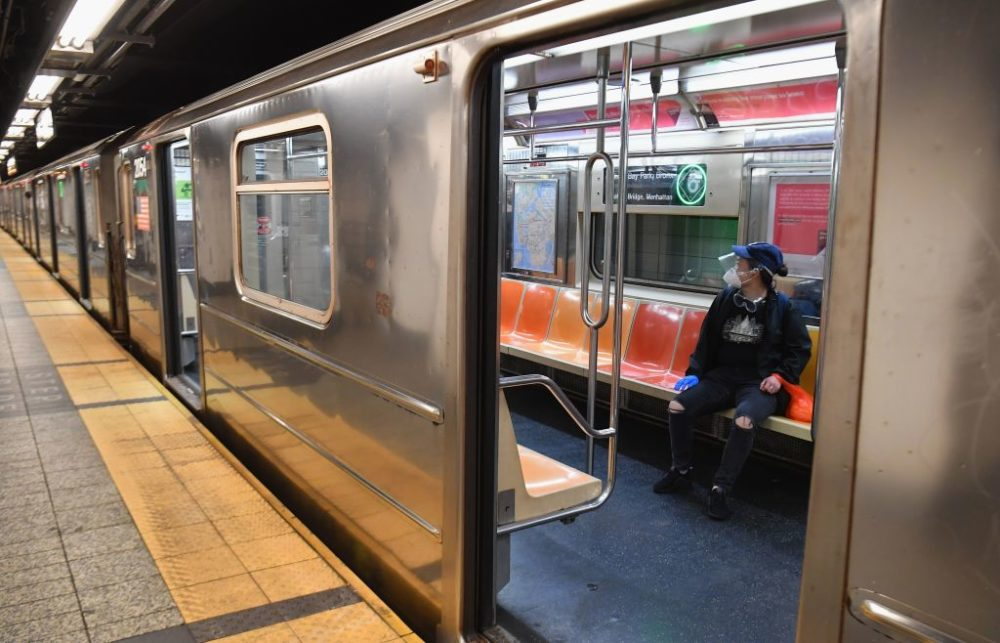 A commuter rides in a MTA subway car during morning rush hour on June 8, 2020, in New York City. (Angela Weiss/AFP/Getty Images)