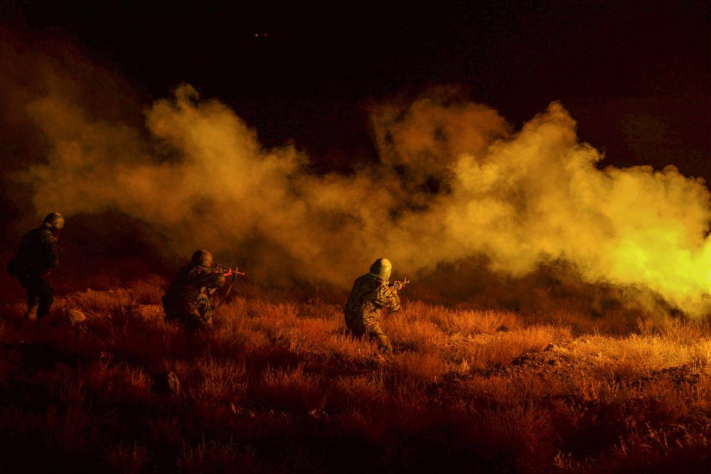 In this picture taken on Nov. 15, 2020 Afghan National Army (ANA) soldiers take part in a military exercise at a base in Guzara, Herat province. (Hoshang Hashimi/AFP via Getty Images)