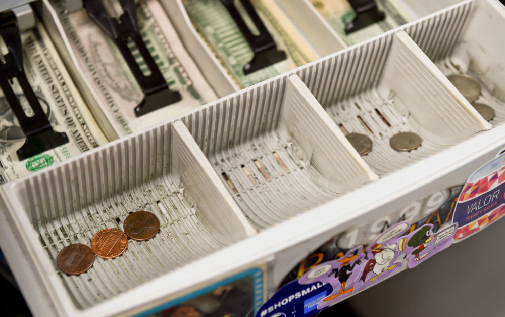 The change drawer of the cash register at Symbiote Collectibles in West Reading, Pennsylvania, on July 9, 2020. (Ben Hasty/MediaNews Group/Reading Eagle via Getty Images)