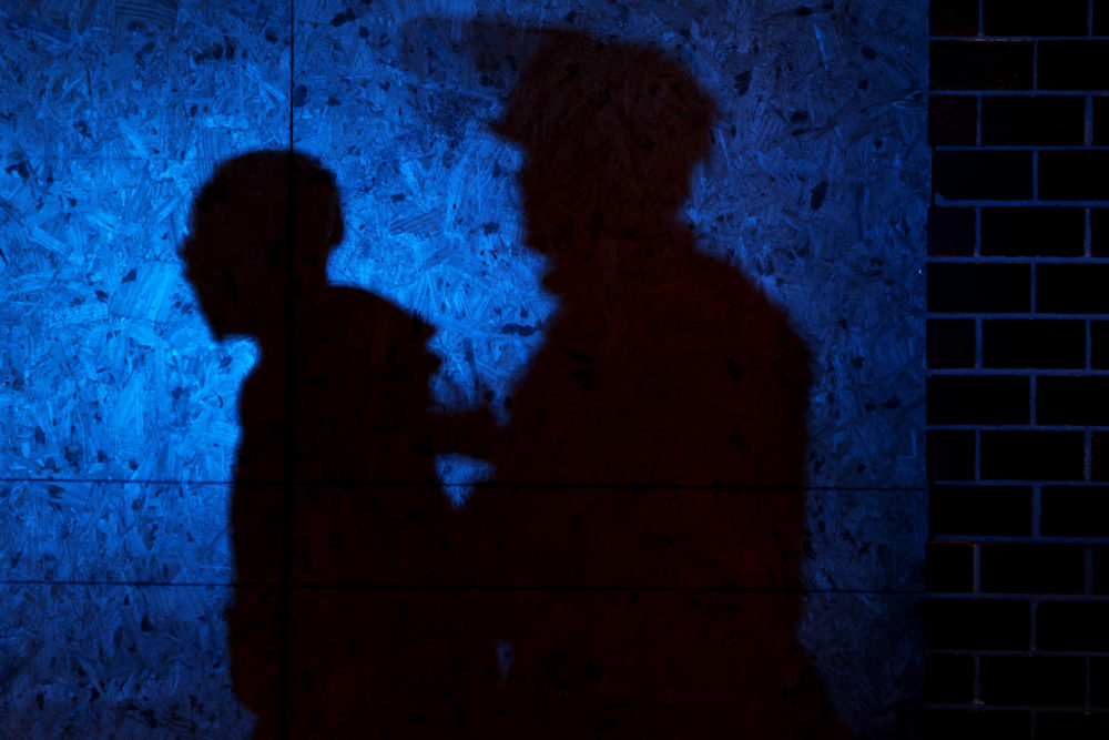 The shadow of a Louisville Police officers arresting a demonstrator is seen on a wall on September 23, 2020 in Louisville, Kentucky. (Michael M. Santiago/Getty Images)