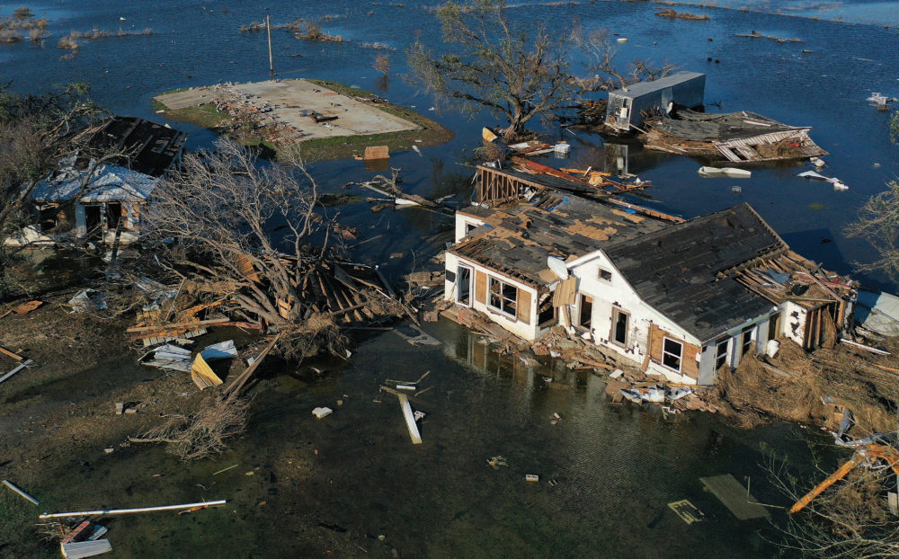 An aerial view of flood waters from Hurricane Delta surrounding structures destroyed by Hurricane Laura on Oct. 10, 2020 in Creole, Louisiana. Hurricane Delta made landfall near Creole as a Category 2 storm in Louisiana initially leaving some 300,000 customers without power.  (Mario Tama/Getty Images)