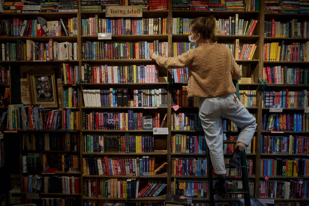 A staff member picks out a book for an order inside Shakespeare and Company Bookshop on Nov. 4, 2020 in Paris, France. (Kiran Ridley/Getty Images)
