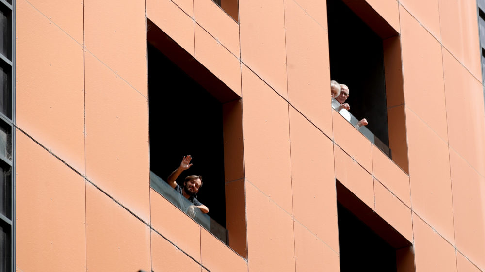 Quarantined hotel quests on the balcony of the Peppers on Waymouth Hotel on November 18, 2020 in Adelaide, Australia. (Kelly Barnes/Getty Images)