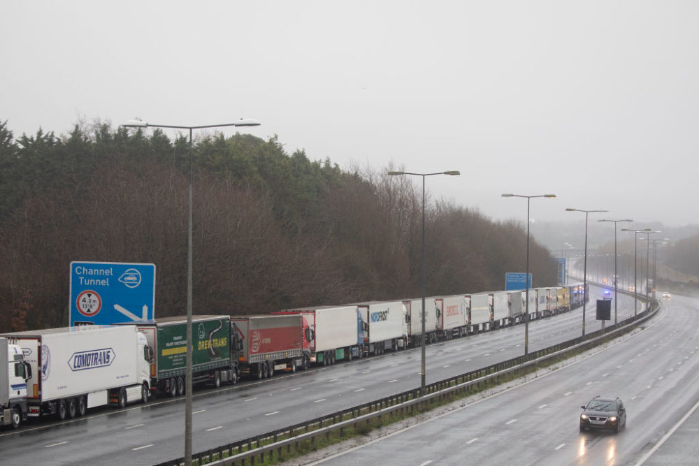 Trucks queue during operation stack toward Dover, England, on December 21, 2020. Citing concern over a new COVID-19 variant and England's surge in cases, France temporarily closed its border with the UK late Sunday, halting freight and ferry departures from the port of Dover for 48 hours. (Dan Kitwood/Getty Images)
