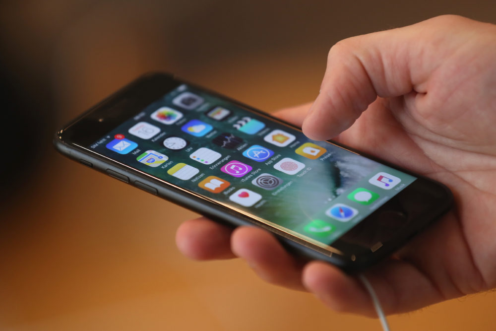 A person holds an Apple iPhone 7. (Sean Gallup/Getty Images)