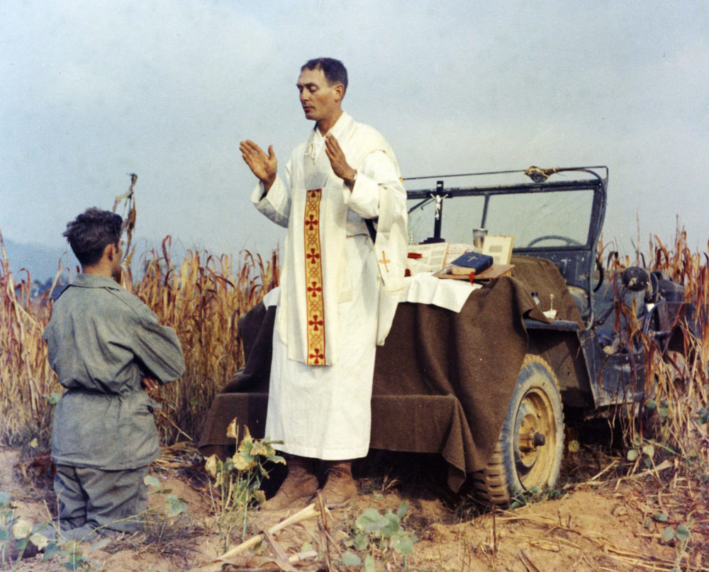 Father Emil Kapaun celebrates Mass using the hood of his jeep as an altar, as his assistant, Patrick J. Schuler, kneels in prayer in Korea on Oct. 7, 1950, less than a month before Kapaun was taken prisoner. Kapaun died in a prisoner of war camp on May 23, 1951, his body wracked by pneumonia and dysentery. On April 11, 2013, former President Barack Obama awarded the legendary chaplain, credited with saving hundreds of soldiers during the Korean War, the Medal of Honor posthumously. (U.S. Army Col. Raymond A. Skeehan)
