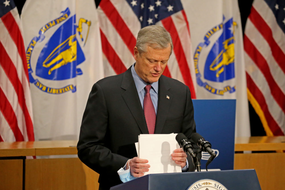 Gov. Charlie Baker finishes up his written remarks as he speaks to the media on the Covid-19 situation in Mass. on Dec. 22. (Stuart Cahill/MediaNews Group/Boston Herald via pool)