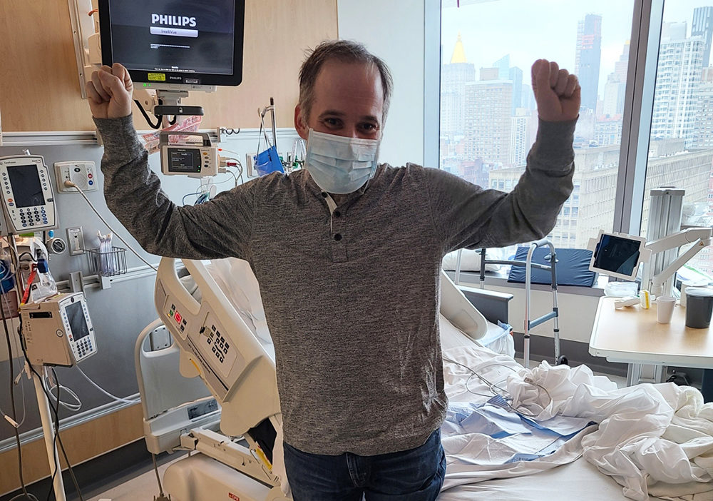 Jeff Gerson stands by his hospital bed after he recovering from the coronavirus. (Courtesy)