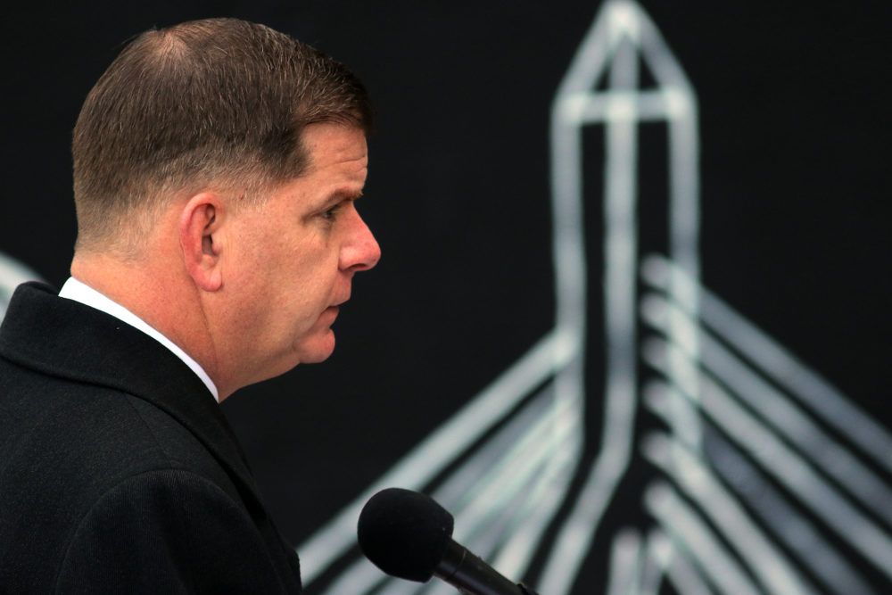 Mayor Marty Walsh gives updated information concerning the COVID-19 pandemic at a press conference outside City Hall in Boston on Dec. 3. (Lane Turner/The Boston Globe via Getty Images)