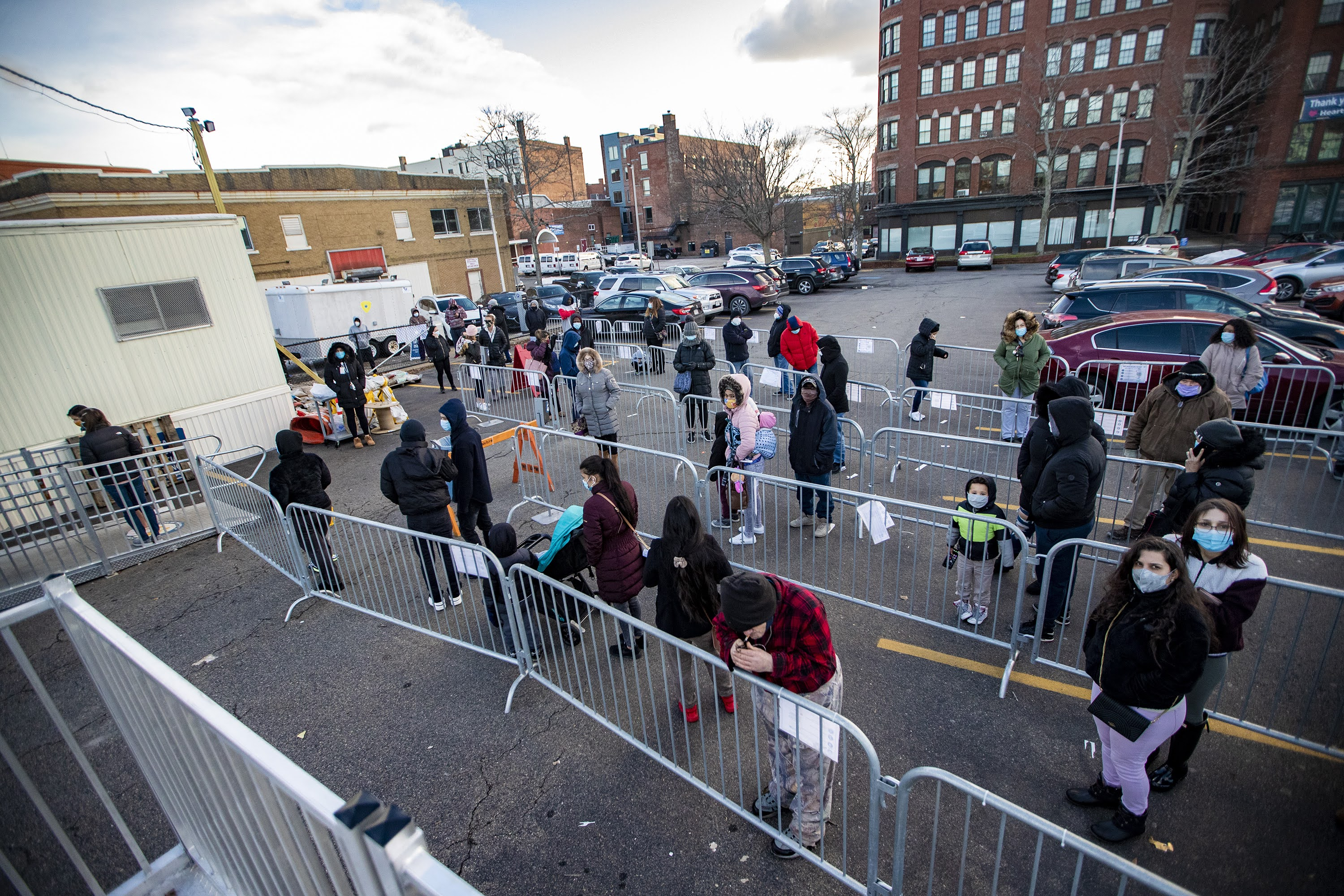 People wait in line for COVID-19 testing at the Lynn Community Health Center on Monday. (Jesse Costa/WBUR)