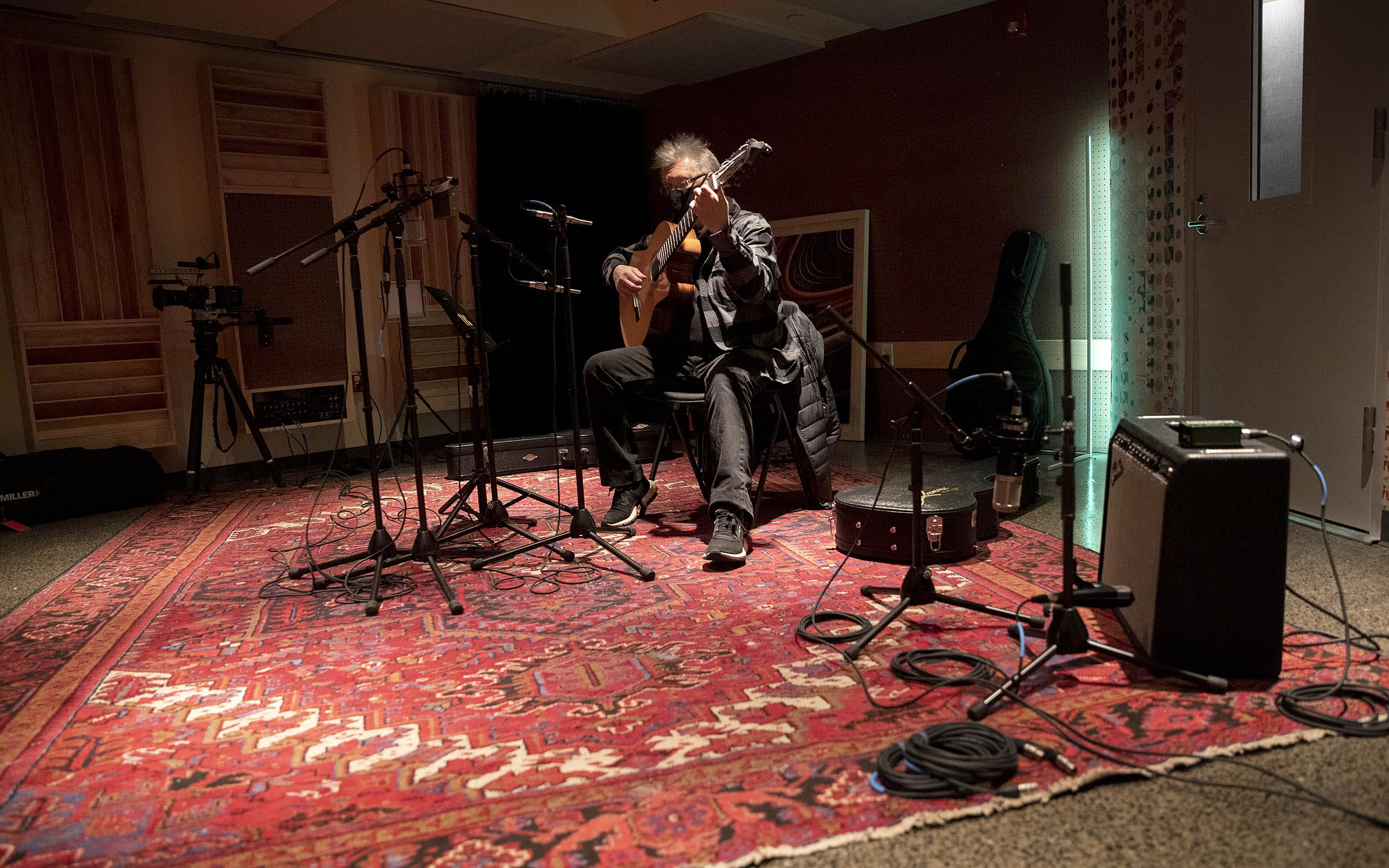 Musician and composer Claudio Ragazzi plays his guitar in the new Studio B at The Record Co. (Robin Lubbock/WBUR)
