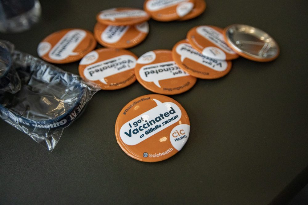 Buttons and wrist bands were handed out to vaccine recipients at the Gillette Stadium Covid-19 Vaccination Site. (Jesse Costa/WBUR)