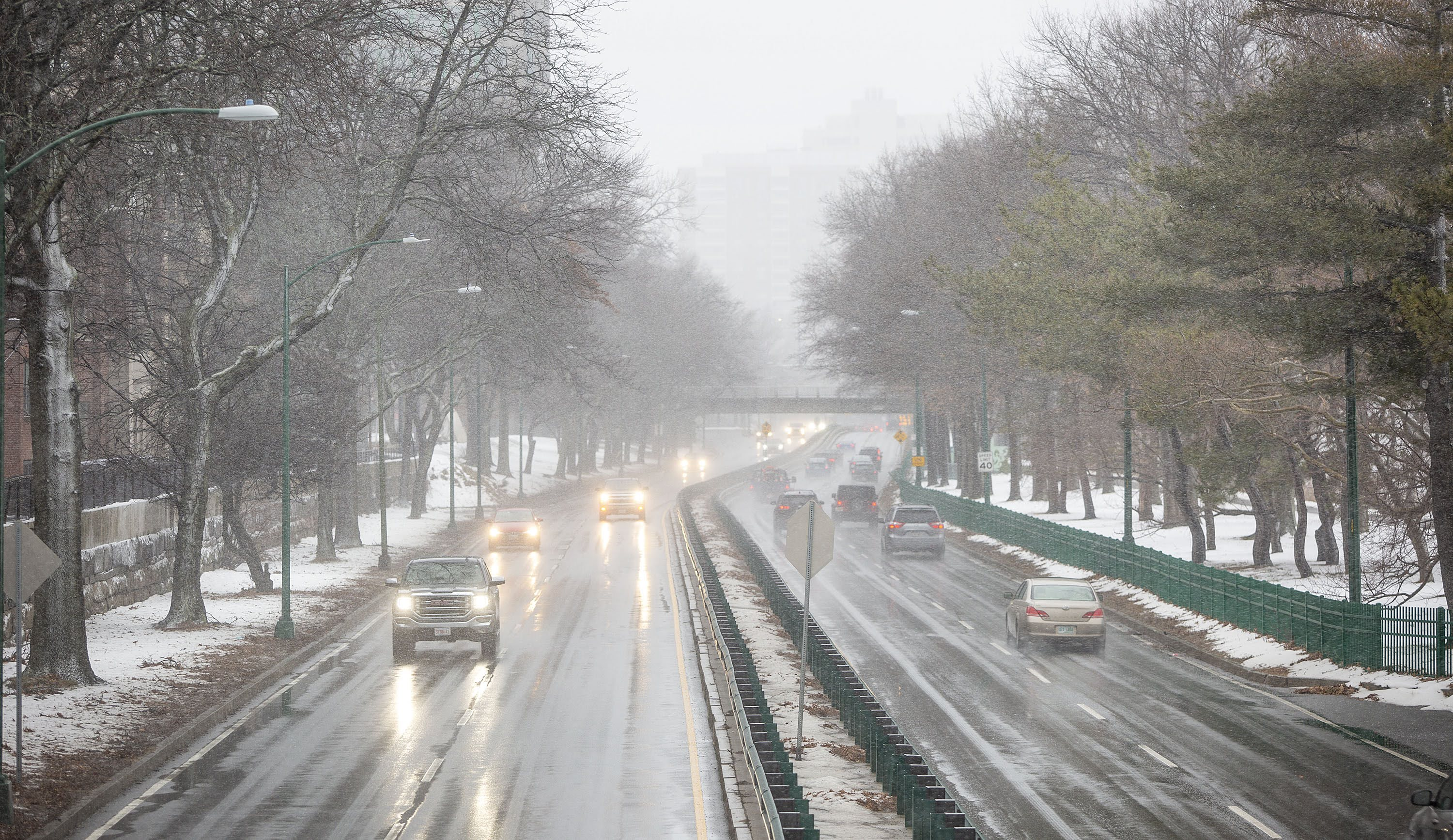Snow falling on Storrow Drive Monday afternoon as the nor'easter moves into Boston. (Robin Lubbock/WBUR)