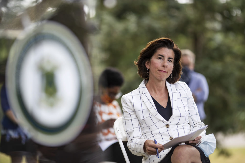 Rhode Island Gov. Gina Raimondo sits during a news conference in Providence. (David Goldman/AP)