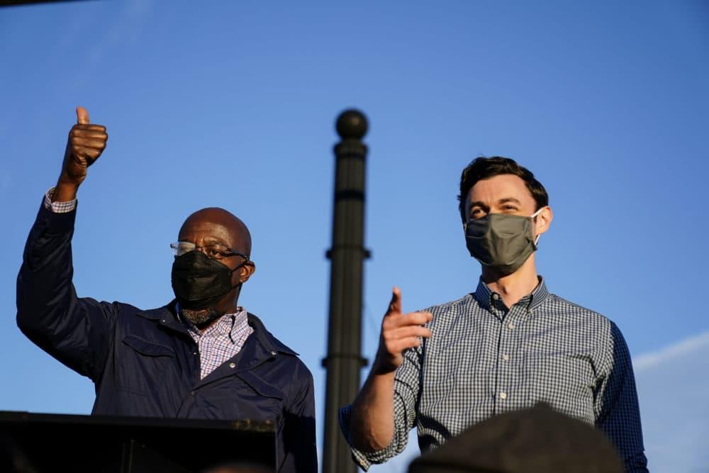 Georgia Democratic candidates for U.S. Senate Raphael Warnock, left, and Jon Ossoff, right, campaigned together in Marietta, Ga., on Nov. 15. (Brynn Anderson/AP)