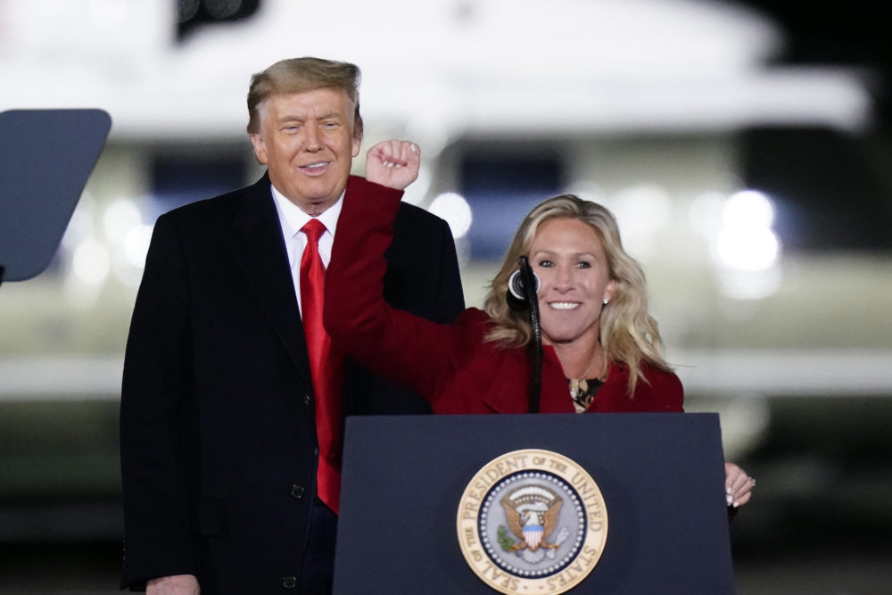 Republican Rep. Marjorie Taylor Greene of Georgia speaks as Trump listens at a campaign rally in support of Senate candidates Kelly Loeffler and David Perdue on Jan. 4, 2021. (Brynn Anderson/AP)