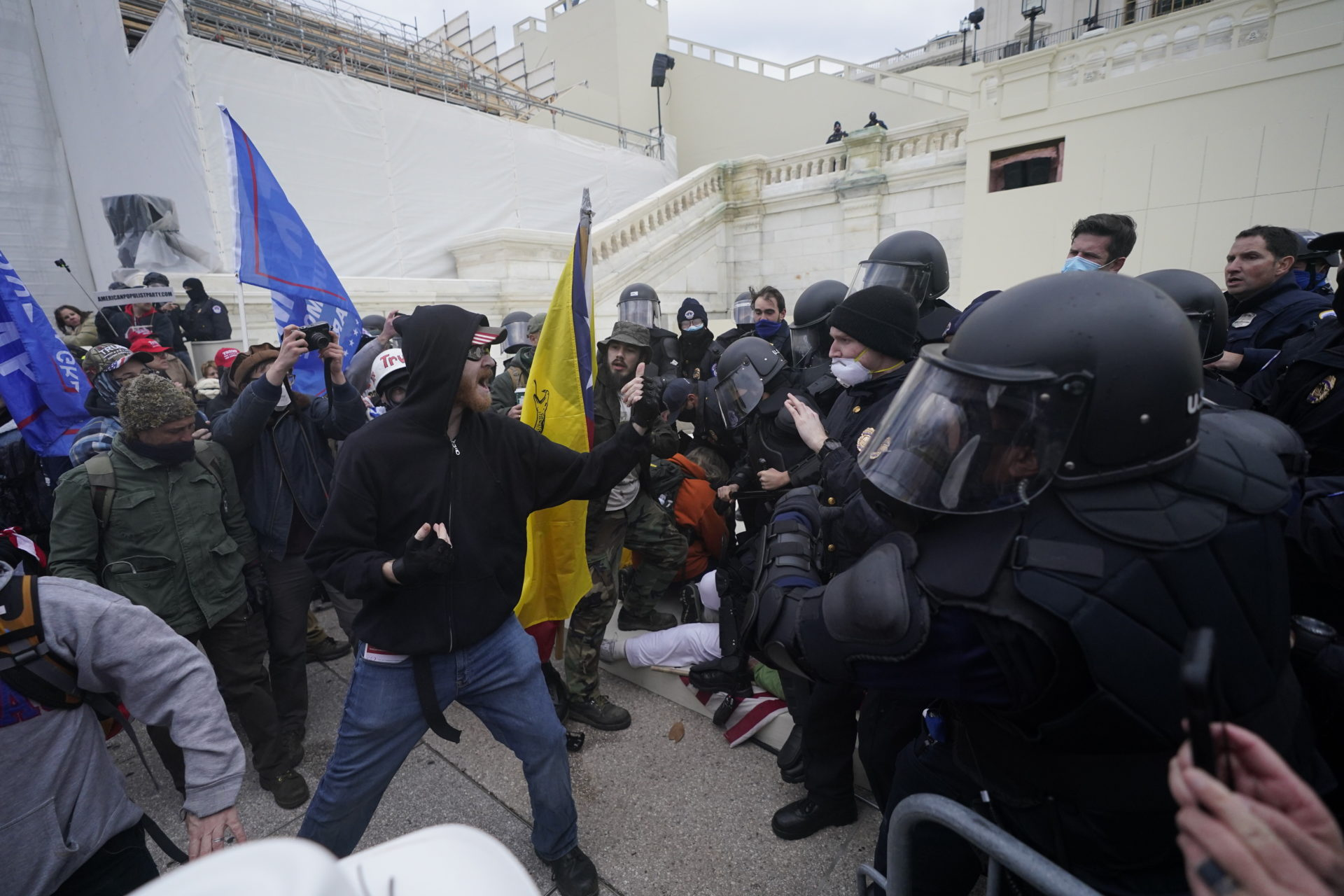 Trump supporters try to break through a police barrier at the Capitol in Washington. (Julio Cortez/AP)
