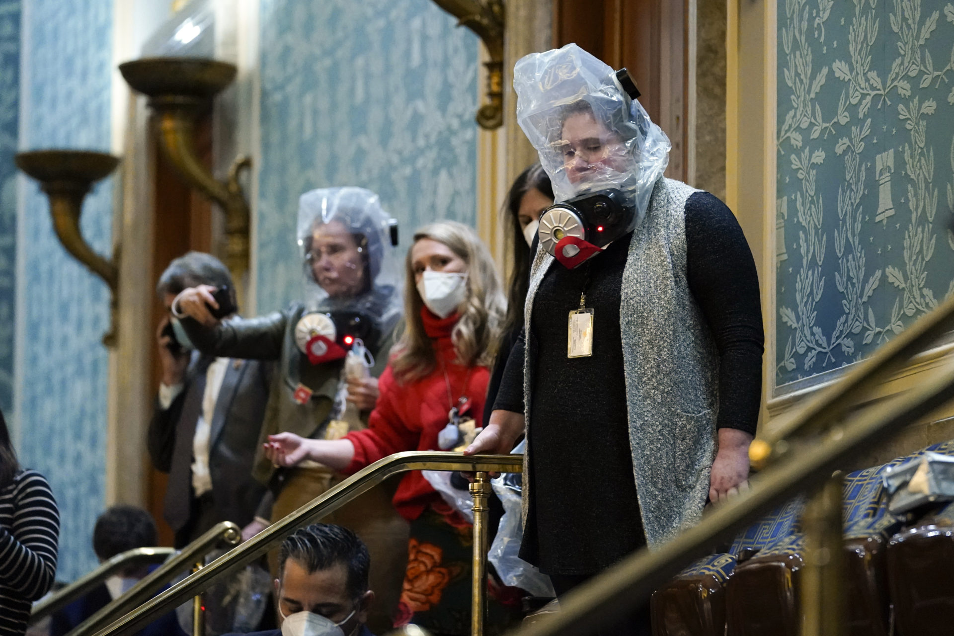 People are seen in the House gallery as protesters try to break into the House Chamber. (Andrew Harnik/AP)