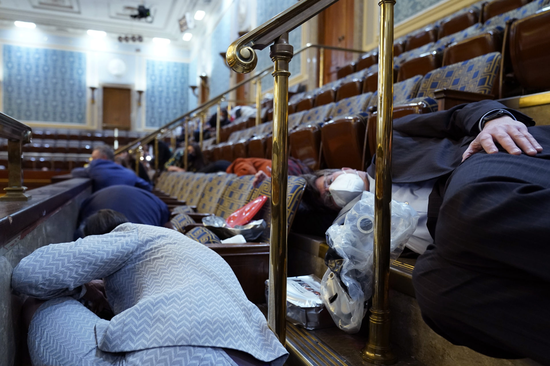 People shelter in the House gallery as protesters try to break into the House Chamber. (Andrew Harnik/AP)