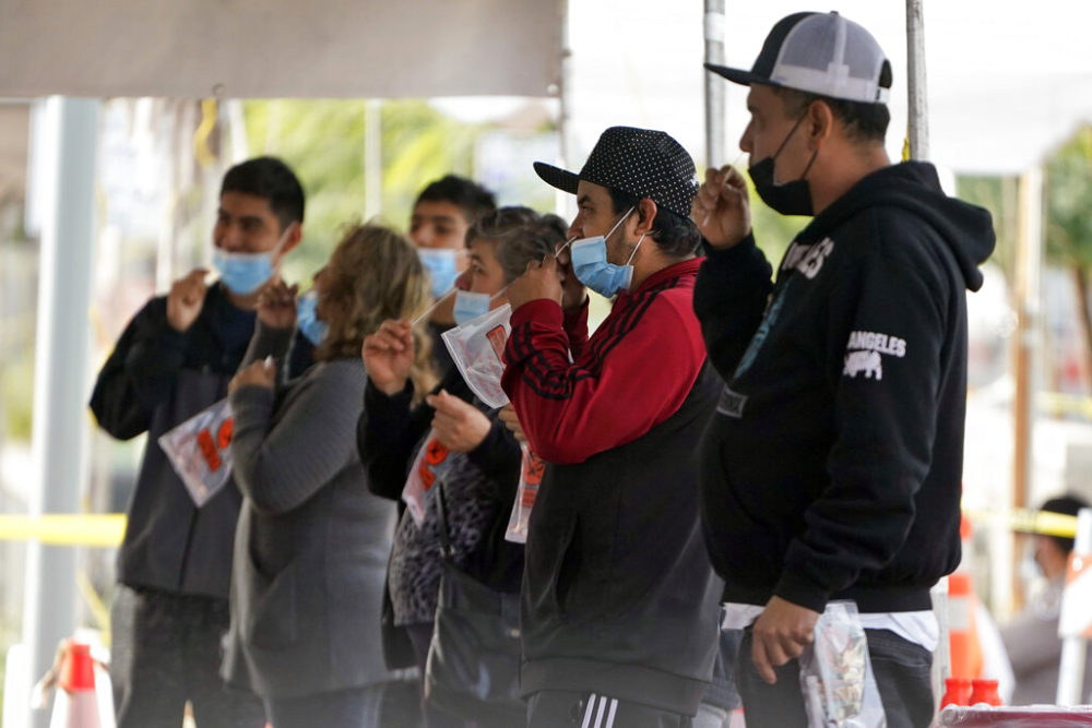 People take a COVID-19 test on the Martin Luther King Jr. Medical Campus in Los Angeles. (AP Photo/Marcio Jose Sanchez)