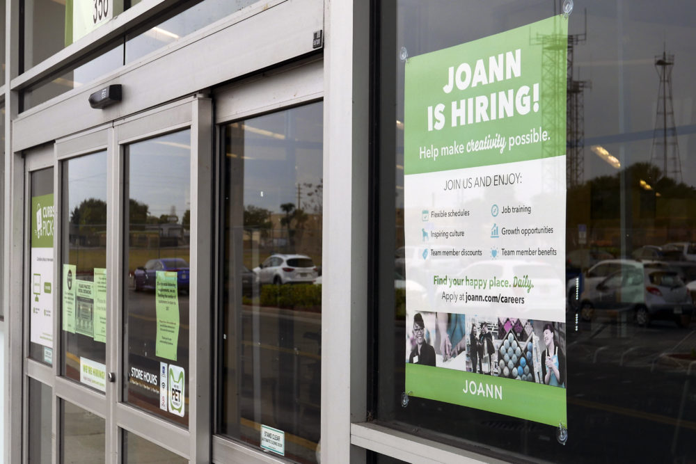 A sign advertising job openings at a JOANN fabric and craft store is displayed near the entrance, Tuesday, Jan. 12, 2021, in Orlando, Fla.  (John Raoux/AP)