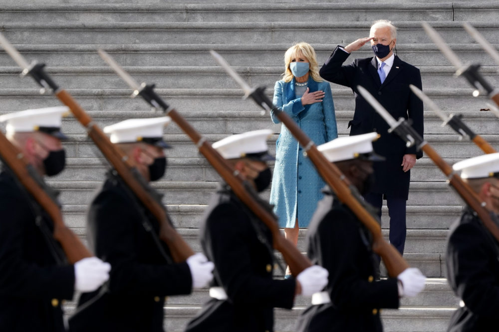 President Joe Biden and his wife Jill Biden watch a military pass in review ceremony on the East Front of the Capitol at the conclusion of the inauguration ceremonies. (J. Scott Applewhite/AP)
