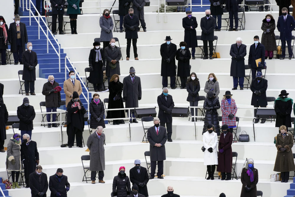 People attend the 59th Presidential Inauguration at the U.S. Capitol in Washington, Wednesday, Jan. 20, 2021. (AP Photo/Carolyn Kaster)