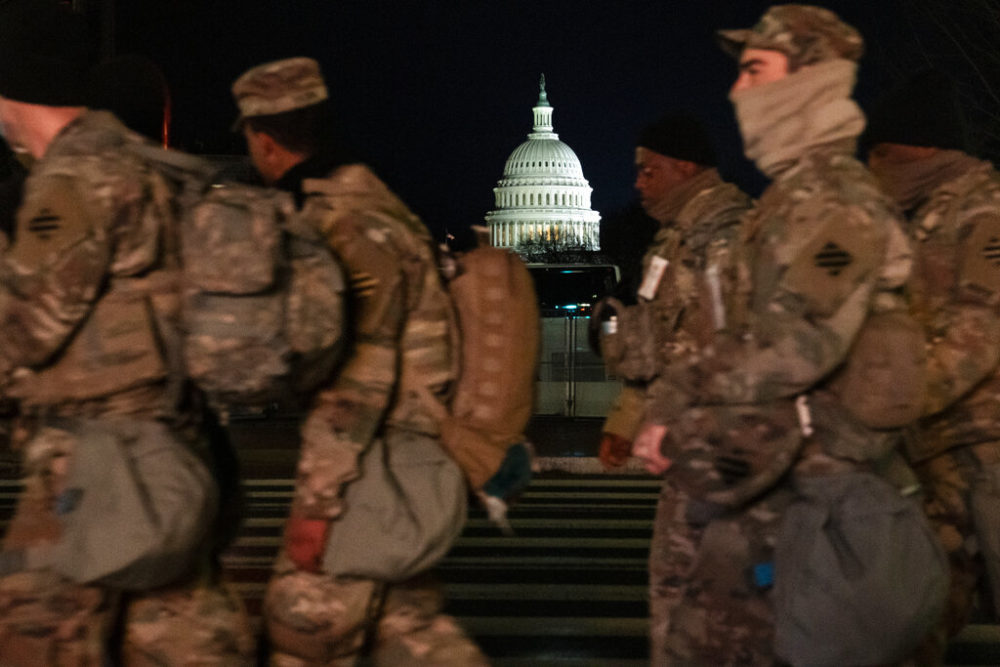 Military personnel march outside the Capitol as security is increased ahead of the inauguration of President-elect Joe Biden and Vice President-elect Kamala Harris, Wednesday, Jan. 20, 2021, in Washington. (AP Photo/John Minchillo)