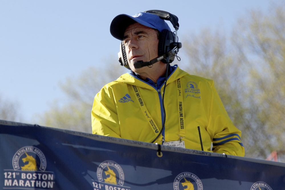 In this 2017 file photo, Race Director Dave McGillivray looks on from the platform at the start of the Boston Marathon in Hopkinton, Mass. Since the 2021 Boston Marathon is on hold until fall, McGillivray has been tapped by the state of Massachusetts to run mass vaccination operations at Gillette Stadium and Fenway Park. (Mary Schwalm/AP File)
