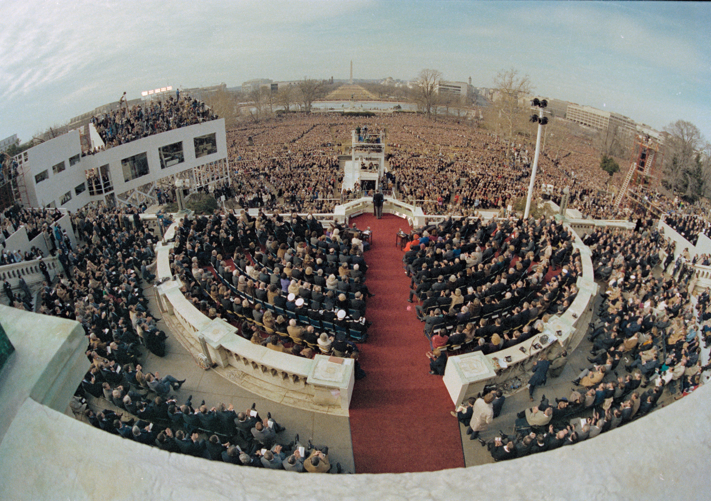 This wide angle view from the Capitol balcony shows U.S. President Ronald Reagan, visible at center, as he addresses the nation following his swearing-in ceremony in Washington, D.C., Jan. 20, 1981. (AP)