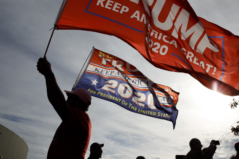 A supporter of President Trump waves flags outside of McKenzie Arena, where U.S. President Donald Trump is holding a rally in support of Republican Senate candidate Rep. Marsha Blackburn, Nov. 4, 2018 in Chattanooga, Tennessee. (Drew Angerer/Getty Images)